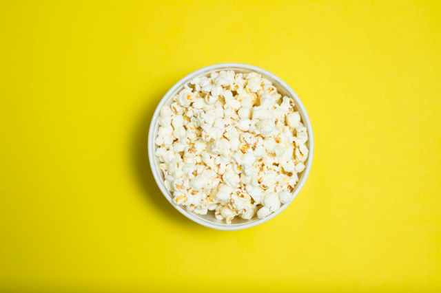 popcorn serving in white ceramic bowl